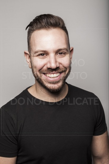 Portrait of young man smiling in studio